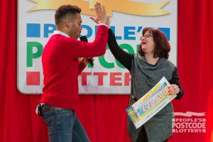 A lucky winner dancing for joy with Danyl Johnson