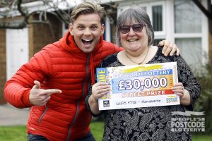 Happy winner Dawn with her £30,000 cheque