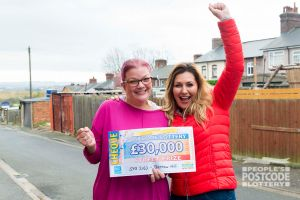 Suzanne celebrating her whopping win with Street Prize Presenter Judie McCourt