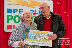 Our top winner Charles collecting his whopping £273,460 cheque with his wife Enid