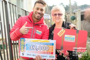 Danyl handing over a Dream Holiday to Jean from Ferndown