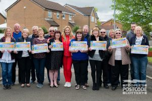 Judie with some lucky Audenshaw residents and their Postcode Millions prizes