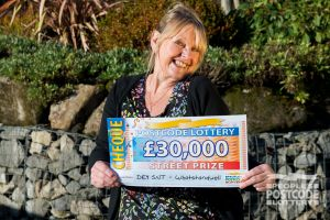Mary with a £30,000 Street Prize cheque