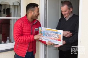 Geoffrey couldn't believe it when Danyl Johnson presented him with a £30,000 cheque