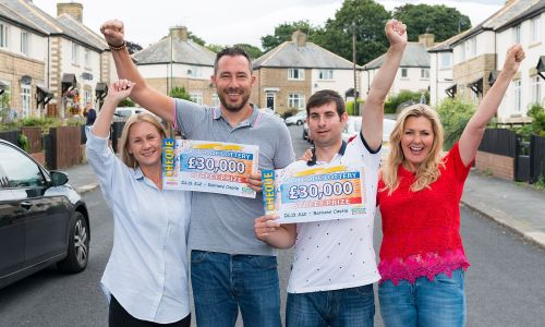 The lucky Barnard Castle winners with their £30,000 cheques