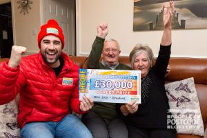 Happy winner Tony with his wife Dot and their fantastic cheque