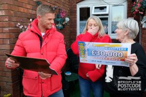Carol, with her daughter Adele, and Jeff Brazier, revealing a whopping Christmas win