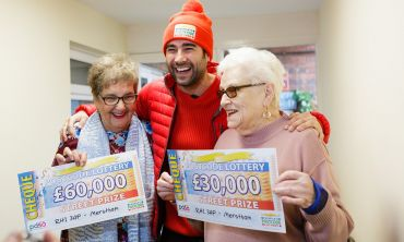 Two the lucky Mertsham winners smiling with Matt Johnson and their fantastic cheques!