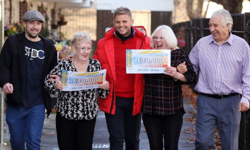 Jeff Brazier with our lucky Eltham Street Prize winners and their whopping £30,000 cheques