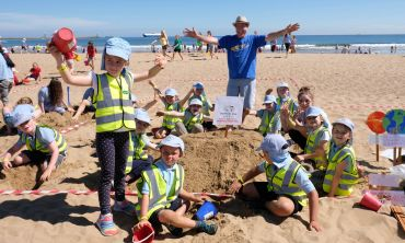 Kids busy building at the Children North East Sandcastle Challenge