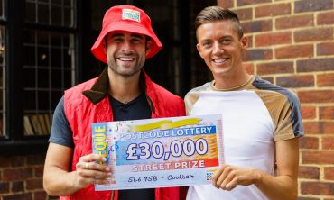 Matt Johnson presents lucky Cookham winner Spencer with his amazing cheque for £30,000
