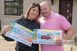 Lucky winner Karen and her husband William with their fantastic cheques