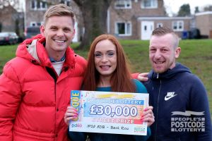 Roxanne, Carl and presenter Jeff with the fabulous £30,000 cheque