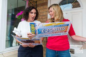 She wasn't expecting to have won £25,000 as well as a new BMW!