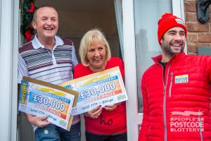Matt with Barbara and Trevor and their two £30,000 cheques!