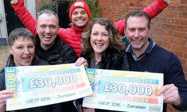 Jeff celebrating with our Dereham winners and their amazing £30,000 cheques