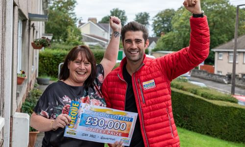 One of the Gowerton winners, Helen, with Matt Johnson and her fantastic cheque