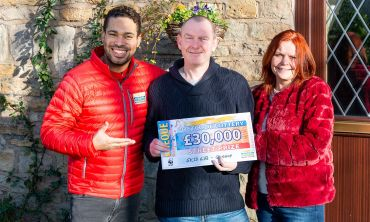 Glossop winner John with his wife Gillian and Street Prize Presenter Danyl Johnson