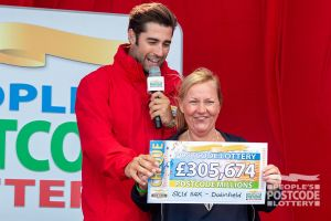Lorna's neighbour Julia also scooped an amazing £305,674!