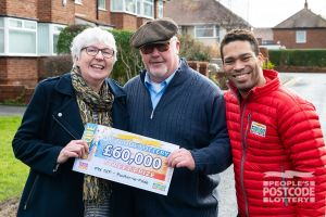 Mike and his wife Sheila with Danyl Johnson and the big £60,000 cheque