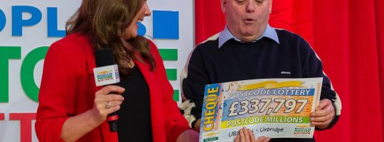 Ian scooped a cheque for a whopping £337,797 at the Postcode Millions party