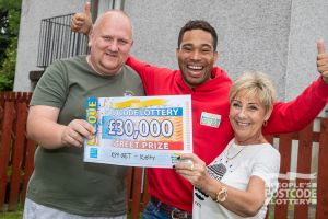 Danyl with delighted winner Margaret and partner Eric holding their £30,000 cheque