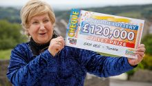 Lucky winner Rosemary with her whopping £120,000 cheque