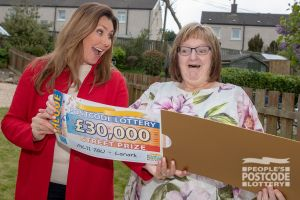 1. Marilyn was absolutely astonished when Street Prize Presenter Judie McCourt revealed her cheque