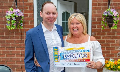 Lucky Doncaster winner Ann and her son Alan with their £30,000 windfall
