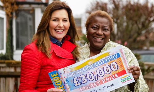 Florence with her £30,000 cheque and presenter Judie McCourt
