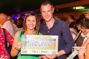 One of our happy Torquay Postcode Millions winners with their fabulous cheque