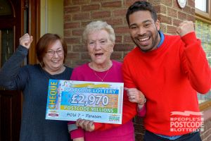 Danyl Johnson celebrates with a Fareham player who picked up £2,970