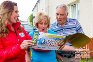 Pat and husband John are speechless as Judie McCourt reveals their £30,000 cheque