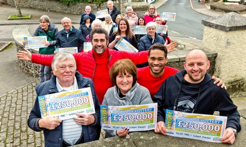 The lucky West Devon winners celebrated in the street with presenters Matt Johnson and Danyl Johnson