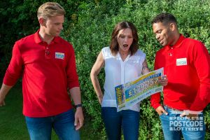 Winner Michelle looking very surprised as Jeff and Danyl reveal her whopping cheque