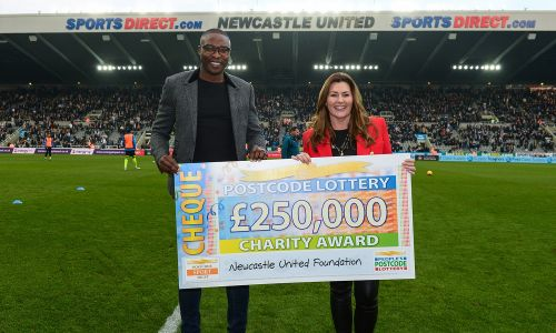 Judie McCourt was joined on the St. James' Park pitch by Newcastle United Foundation patron Shola Ameobi