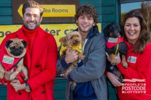 Love Island star Eyal Booker helped the lucky Postcode Millions winners celebrate at Dogs Trust, Harefield