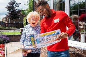 Joan showing her surprise when Danyl revealed her £30,000 cheque