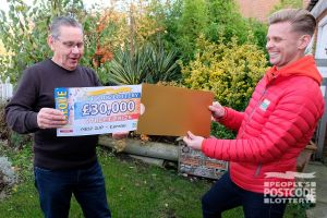 Our winner Alan receives his £30,000 cheque from Jeff Brazier