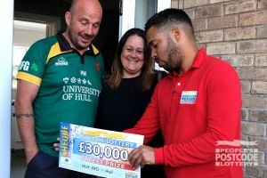 Lucky neighbour Kelly with her husband Matt as Danyl reveals her £30,000 cheque