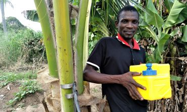 Carlitos with an Oxfam GB Lifesaver cube, which helps convert raw water into clean and safe drinking water