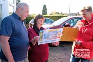 Margaret and husband Ian looking surprised as Jeff reveals their £30,000 windfall
