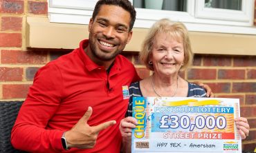 Danyl Johnson celebrating with Jean, one of our lucky Amersham winners