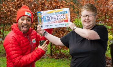 One of our delighted Ammanford winners celebrating with Street Prize Presenter Danyl Johnson