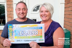 Adrian and Leesa with their Postcode Millions cheque