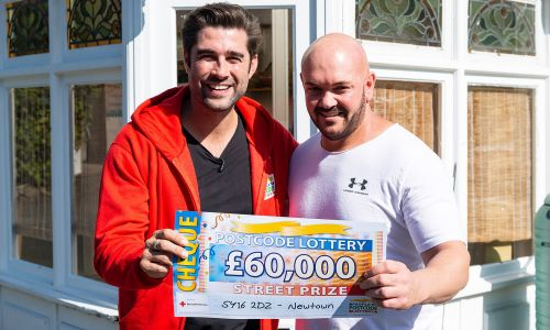 Lucky Newtown winner Ross with Matt Johnson and a cheque for £60,000!