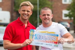 Street Prize Presenter Jeff Brazier with our winner David holding his £30,000 cheque