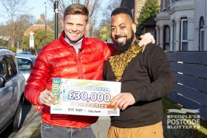 Jeff with happy winner Theo and his £30,000 cheque