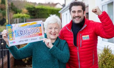 Matt Johnson with our lucky winner Barbara and a superb cheque for £30,000!