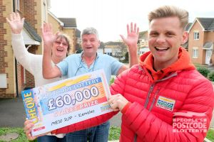 Jeff with winner Barry and wife Trudie. They collected £60,000 due to playing with two tickets!